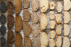 Bakery concept. Plenty of sliced bread background. Sliced sorts of bread gradient pattern background. Bakery and grocery concept. Black, rye and white loaves stock photo