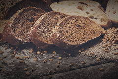 Bakery concept. Plenty of sliced rye bread background. Plenty of sliced bread background. Bakery and grocery concept. Fresh, healthy whole grain sliced sorts of Stock Photography