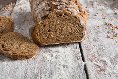Bakery concept. Plenty of sliced rye bread background. Sliced rye bread, bakery background on rustic wood, closeup, copy space Royalty Free Stock Photo
