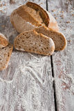 Bakery concept. Plenty of sliced rye bread background. Sliced rye bread, bakery background on rustic wood, closeup, copy space stock images