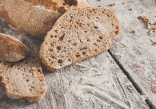 Bakery concept. Plenty of sliced rye bread background. Sliced rye bread, bakery background on rustic wood, closeup, copy space Stock Photography