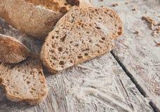 Bakery concept. Plenty of sliced rye bread background. Sliced rye bread, bakery background on rustic wood, closeup, copy space stock photography