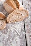 Bakery concept. Plenty of sliced rye bread background. Sliced rye bread, bakery background on rustic wood, closeup, copy space stock image