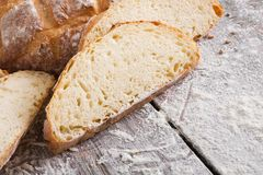 Bakery concept. Plenty of sliced white bread background. Sliced white bread, bakery background on rustic wood, closeup, copy space stock photo