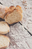 Bakery concept. Plenty of sliced white bread background. Sliced white bread, bakery background on rustic wood, vertical, closeup, copy space royalty free stock photo