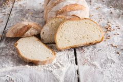 Bakery concept. Plenty of sliced white bread background. Sliced white bread, bakery background on rustic wood, closeup, copy space stock images