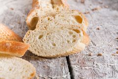 Bakery concept. Plenty of sliced white bread background. Sliced white bread, bakery background on rustic wood, closeup, copy space stock photography