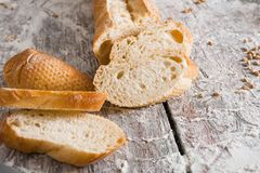Bakery concept. Plenty of sliced white bread background. Sliced white bread, bakery background on rustic wood, closeup, copy space stock image