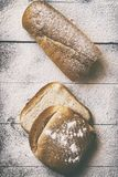 Bakery concept. Sliced bread and loaf of bread stock photo