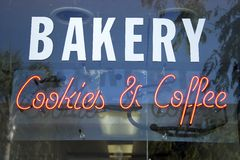 Bakery, cookies & coffee. Neon sign in bakery window Stock Images