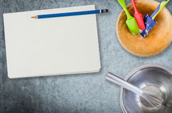 Bakery cooking equipment with notebook for recipe Royalty Free Stock Photography