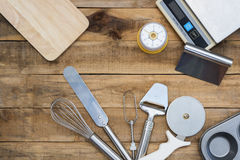 Bakery And Cooking Tools with kitchen timer, scales on wood tabl Royalty Free Stock Photo