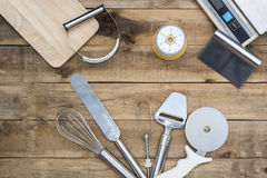 Bakery And Cooking Tools with kitchen timer, scales on wood tabl Royalty Free Stock Photography