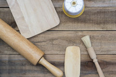Bakery And Cooking Tools with kitchen timer on wood table Royalty Free Stock Image