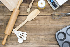 Bakery And Cooking Tools with kitchen timer on wood table Stock Image