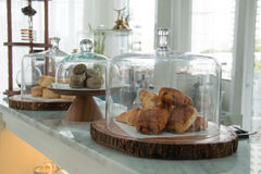 Bakery displayed in glass bell. Display in bakery shop Stock Photos