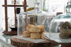 Bakery displayed in glass bell. Display in bakery shop Royalty Free Stock Image