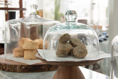 Bakery. displayed in glass bell. Bakery display in shop Royalty Free Stock Image