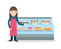 Bakery female salesperson with cakes. Grocery store or bakery shop female salesperson against vitrine with cakes and pastry in flat style. Smiling gesturing Royalty Free Stock Photography