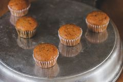 Bakery fresh banana cup cake hot from oven. Home made food royalty free stock image