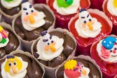 Bakery fresh strawberry and chocolate cartoon cupcakes