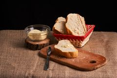Bakery - gold rustic crusty loaves of bread and buns on black chalkboard background. Still life captured from above. Bakery - gold rustic crusty loaves of bread stock photo
