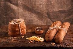 Bakery - gold rustic crusty loaves of bread and buns on black chalkboard background. Still life captured from above. Bakery - gold rustic crusty loaves of bread stock photos