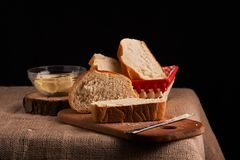 Bakery - gold rustic crusty loaves of bread and buns on black chalkboard background. Still life captured from above. Bakery - gold rustic crusty loaves of bread royalty free stock images