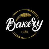 Bakery hand written lettering logo, label, badge, emblem. Vintage style. Golden wheat. Isolated on black background. Vector illustration Stock Photo