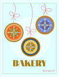 Bakery with hanging three cakes - plum, marmalade Royalty Free Stock Images