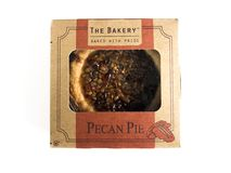 The Bakery Individual Size Pecan Pie. On a white backdrop stock images