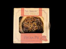 The Bakery Individual Size Pecan Pie. On a black backdrop stock photos