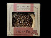 The Bakery Individual Size Pecan Pie. On a black backdrop royalty free stock photography