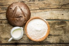 Bakery ingredients with loaf of bread Royalty Free Stock Images
