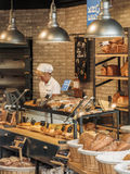 Bakery interior. Interior of a bakery showing the shop clerk helping a client Royalty Free Stock Photo