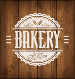 Bakery Label. Vintage Vector Bakery Label or Emblem on Wooden Texture Background Royalty Free Stock Photography