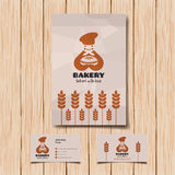 Bakery logo and business card. Smiling baker with bread Royalty Free Stock Photo