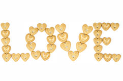 Bakery - Love biscuits. Bakery - Alphabetic letters from heart shaped biscuits - Isolated on white Stock Photos