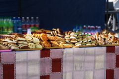 The bakery at the new year`s fair offers a variety of cakes and hot mulled wine, royalty free stock photo
