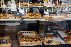 Bakery and pastry shop display window with variety of breads, pies, traditional Spanish empanadas Stock Photo