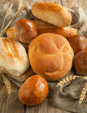 Bakery product assortment with bread loaves and buns. Selective focus Royalty Free Stock Photo