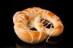 Bakery product. Fresh bakery product pretzel on black background Royalty Free Stock Image