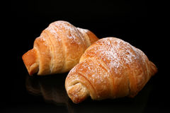 Bakery product. Fresh sweet croissant  on black background Stock Photography