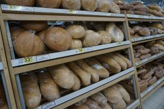 Counters with bread and prices in the store stock images