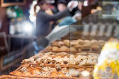 Bakery products on display. Against the background of ovens in the bakery stock photography
