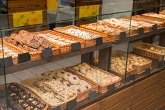 Bakery products on display. Against the background of ovens in the bakery stock photo