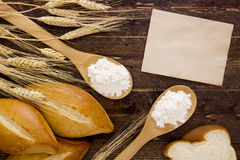 Bakery products flour in a wooden spoon Royalty Free Stock Photos