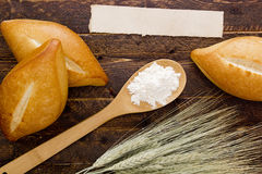 Bakery products flour in a wooden spoon Stock Photo
