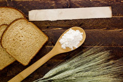 Bakery products flour in a wooden spoon Stock Photography