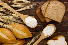 Bakery products flour in a wooden spoon Stock Images